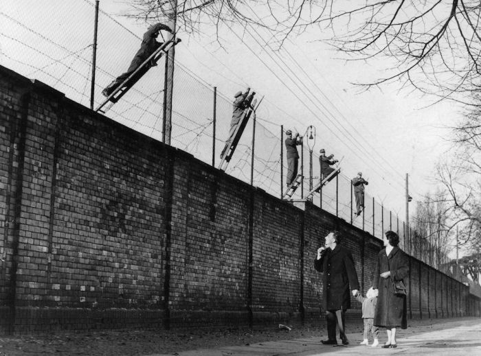 Berlin, Germany, 19th November, 1961, East Berlin border guards adding barbed wire to the newly built Berlin Wall, The wall was set up the Soviet army to prevent refugees escaping from the Soviet sector in the East to West Berlin