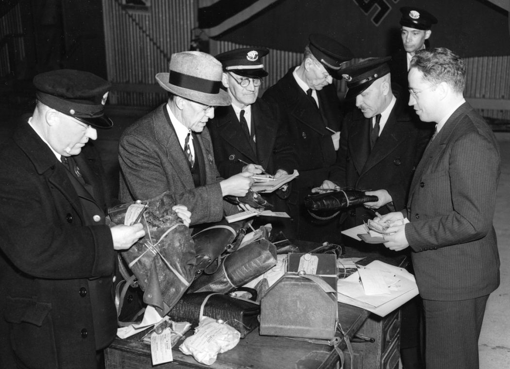 Image result for Custom officials search through baggage recovered from the Hindenburg disaster