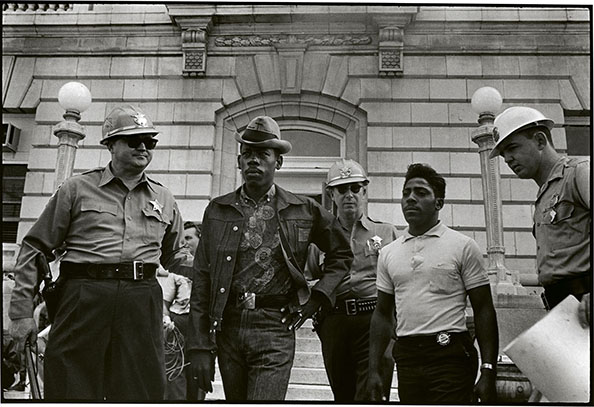 Danny Lyon Sheriff Jim Clark arrests two demonstrators who displayed placards on the steps of the federal building in Selma, 1963