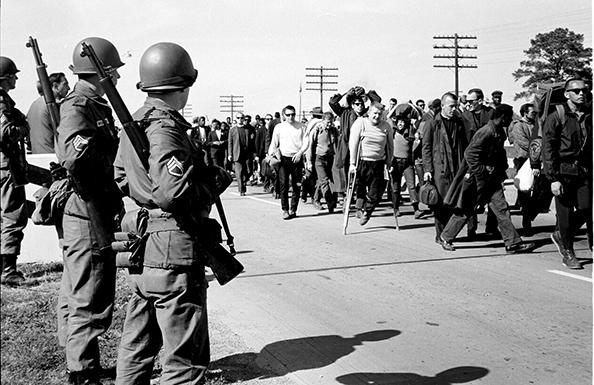Steve Schapiro Troopers Watching Marchers, Selma to Montgomery, 1965