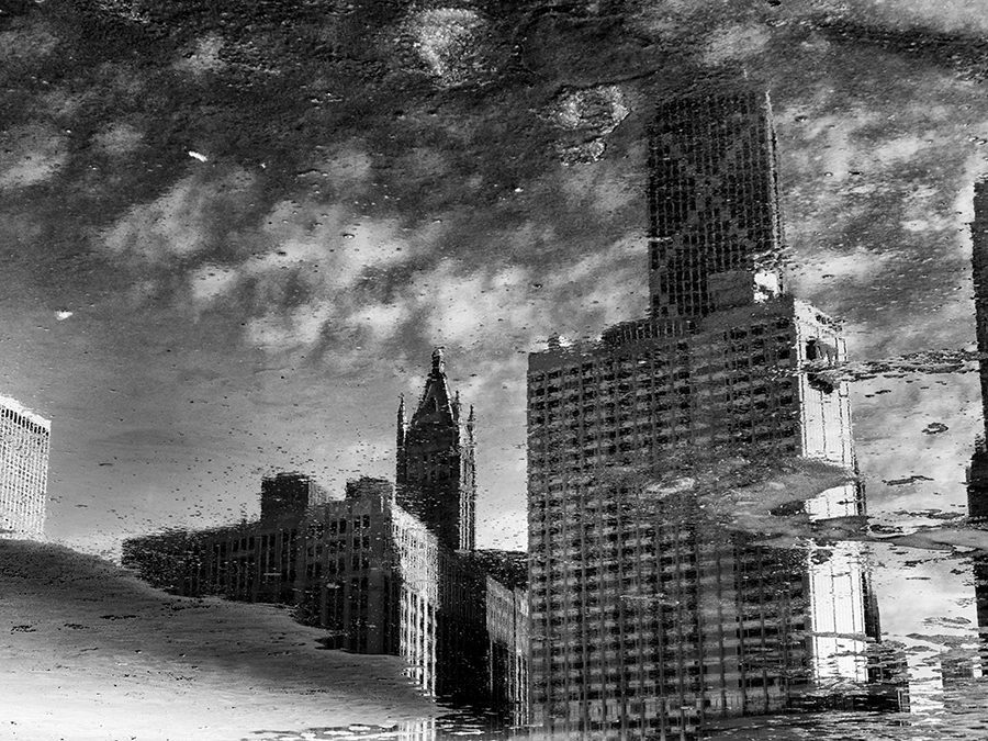 Cityscape reflected in puddles on Ohio Street Beach, Chicago