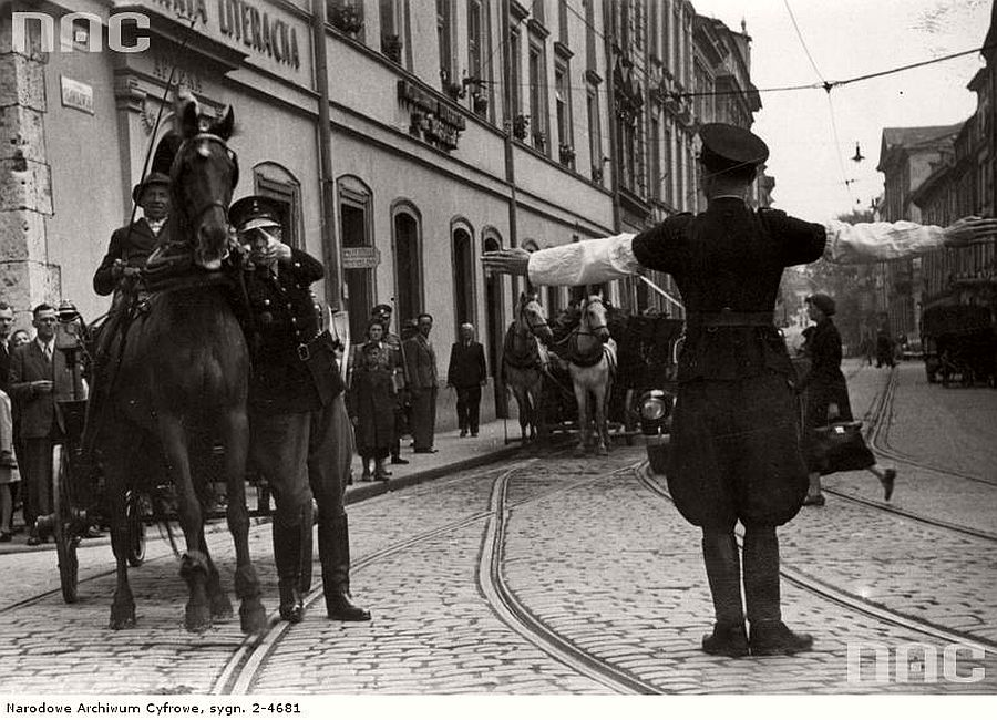 polish-police-officer-while-directing-traffic-in-krakow-visible-slawkowska-street-1941