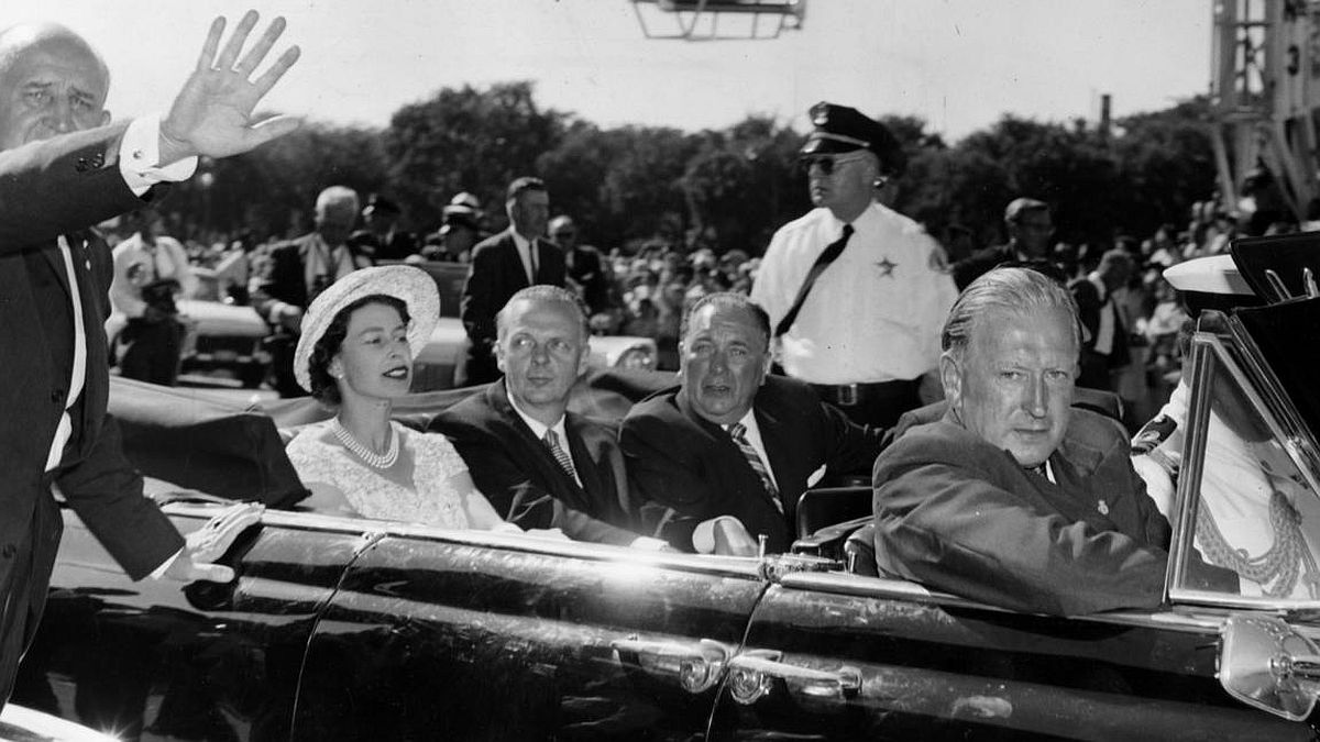 Chicago Tribune historical photo Queen Elizabeth II rides in a car with Gov. William Stratton and Mayor Richard J. Daley on July 6, 1959, in Chicago.