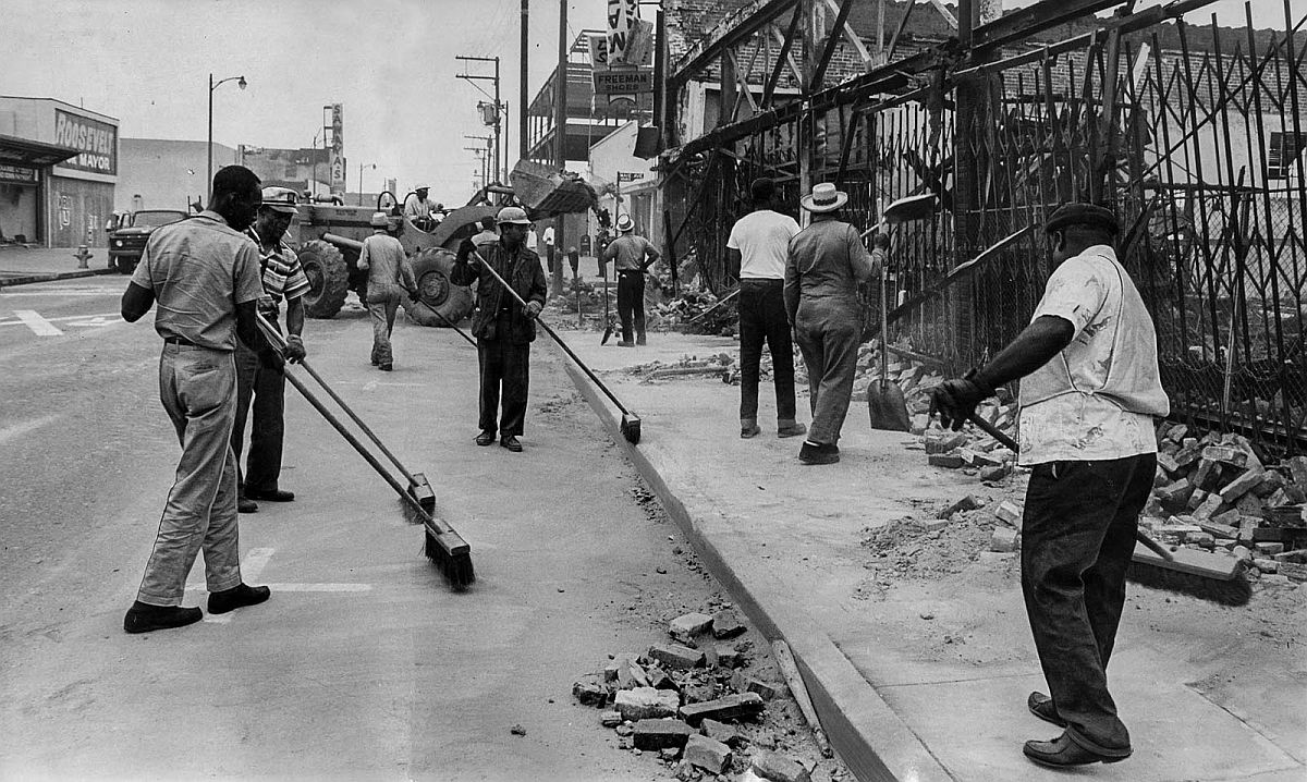 Aug. 20, 1965: Dept. of Public Works clean up crew at 103rd st. and Maie Ave., following the Watts Riots.