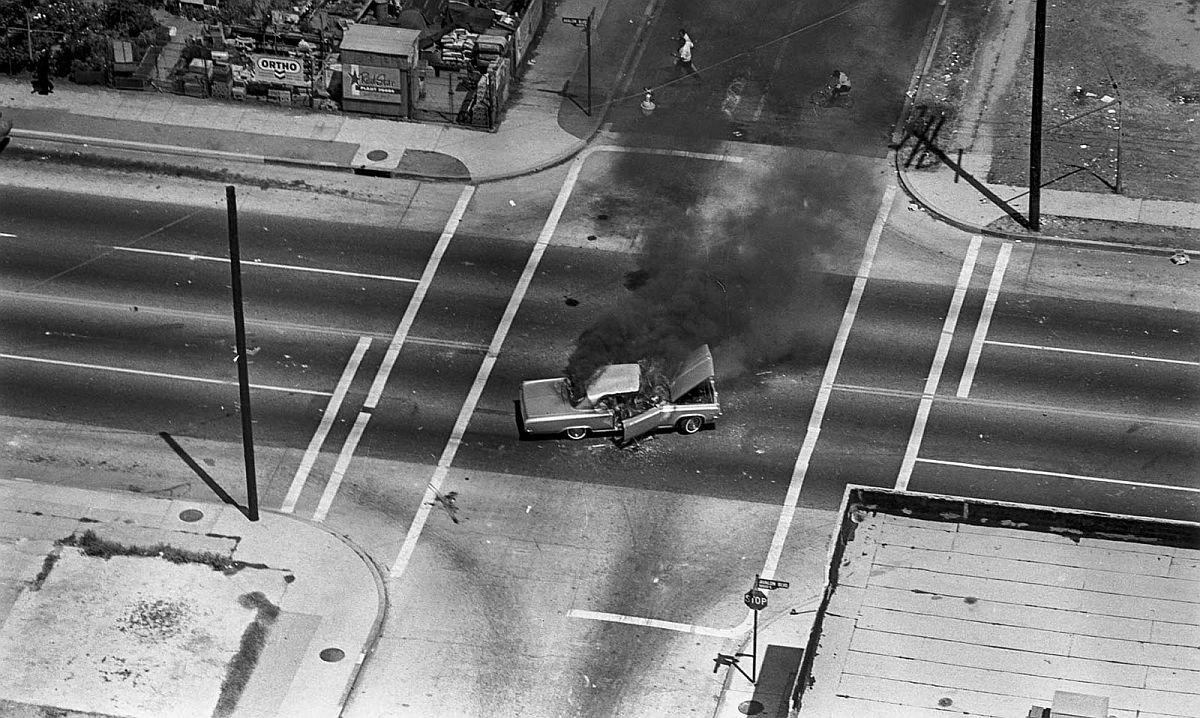 Aug. 13, 1965: Car burns in intersection of Avalon Blvd. during Watts Riots.