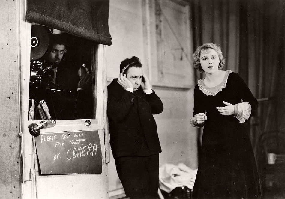 Hitchcock on the set of Blackmail (1929) with the film's star Anny Ondra. Blackmail was started as a silent in spring 1929, before the decision was taken to make it a full talkie. The only problem with this was the Czech star Ondra's heavy accent, which was unsuited to her role as a West London shopkeeper's daughter. Hitchcock is pictured here conducting a sound test. He came up with the novel solution of using English actor Joan Barry to stand off camera and speak Ondra's lines.