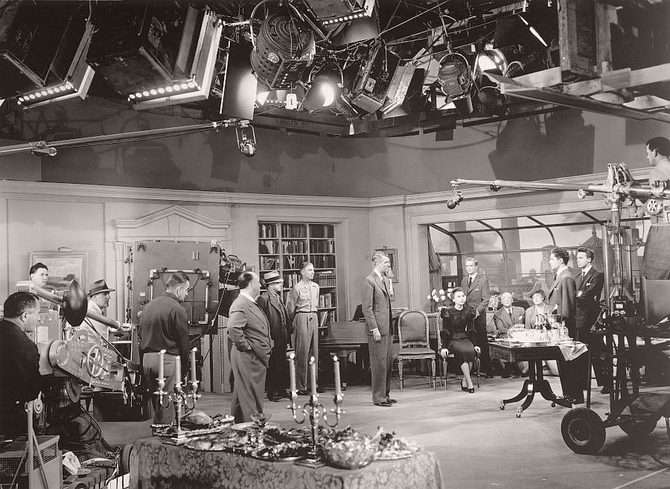 The elaborate setup of Rope (1948), the story of two student killers who host a party in the apartment where the body of their victim is concealed. For Hitchcock's experiment in long, unbroken takes, the walls and furniture of the apartment set had to be moved by out-of-shot prop men to accommodate the roaming camera.