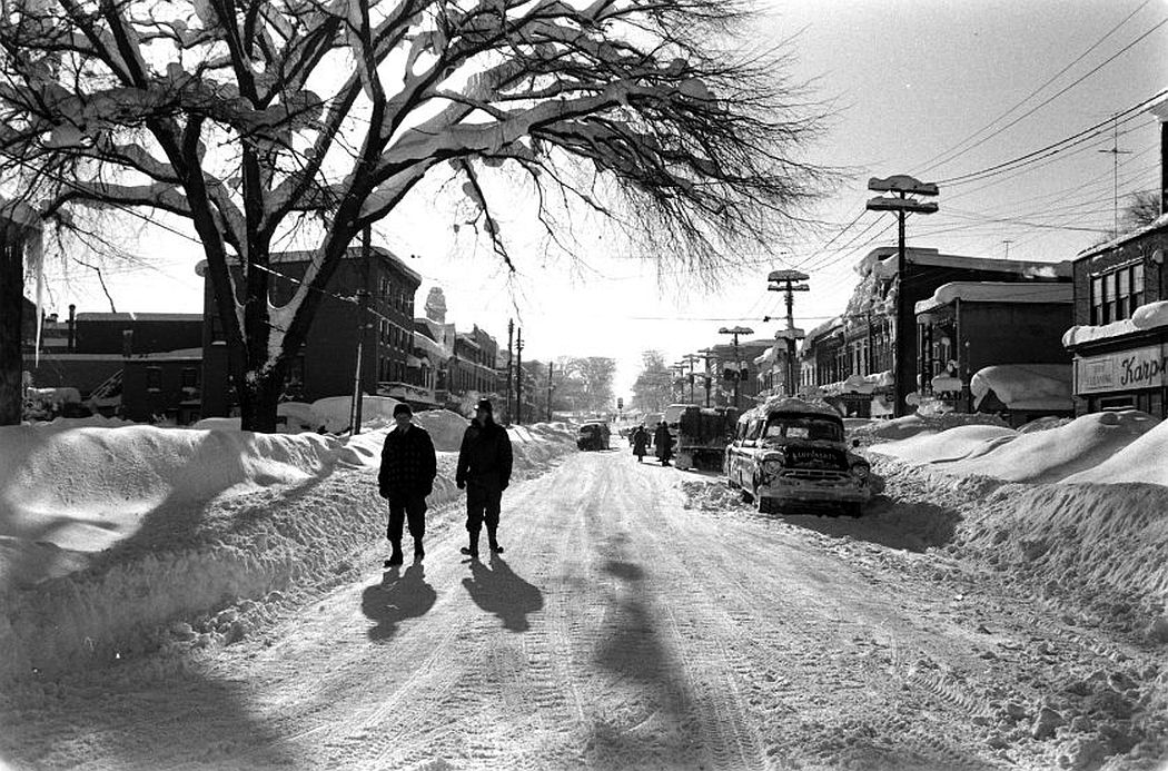 People walk in the streets after a storm dumped six feet of snow on Oswego, New York.