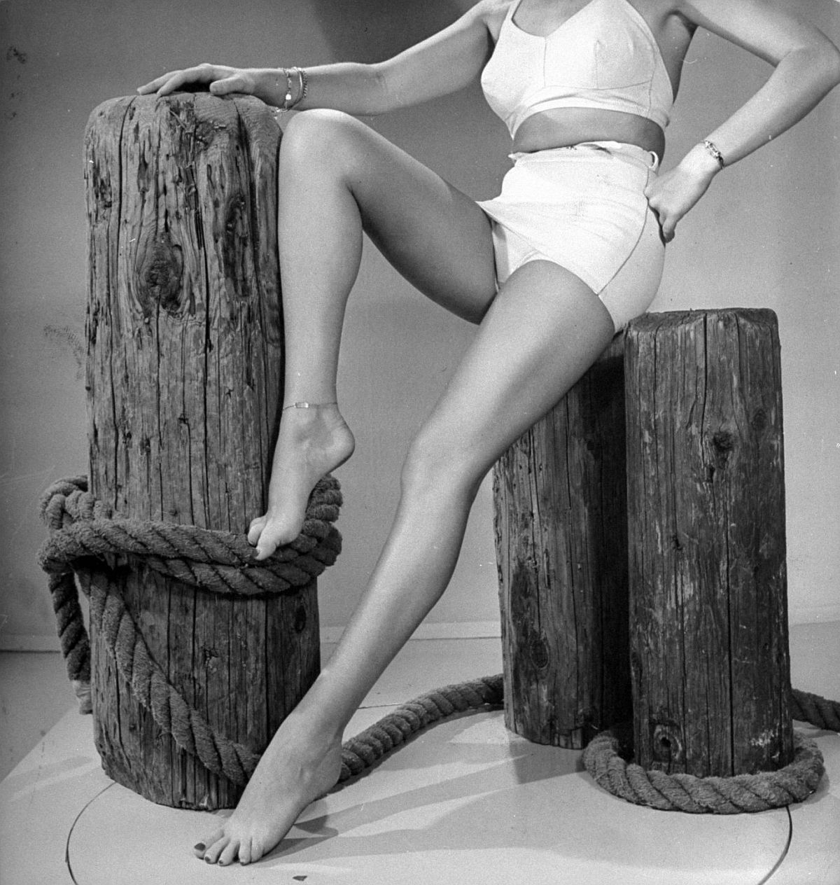 Betty poses the legs for a still shot on a studio beach set. She has made more such leg art stills than any other actress.