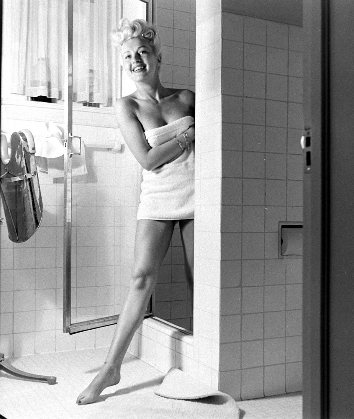 In the course of a day Betty's legs walk, climb stairs, dance and are generally flexed like other legs. Here the legs are shown as she prepares morning shower at home.