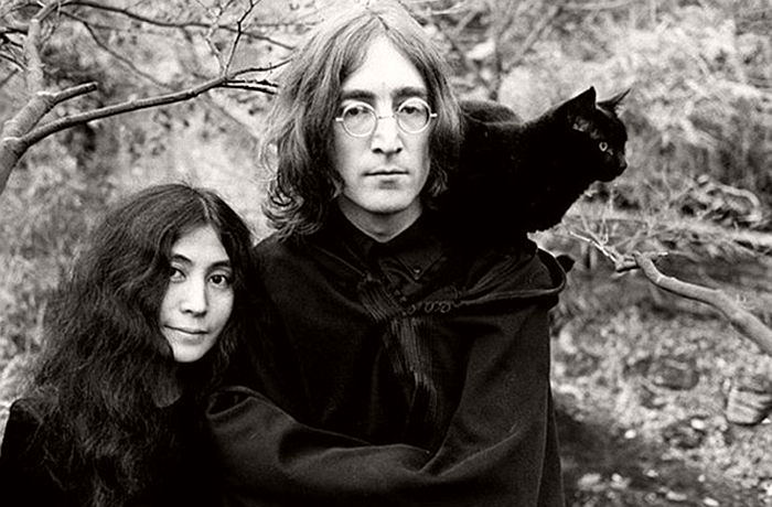 John Lennon and Yoko Ono and a black feline friend