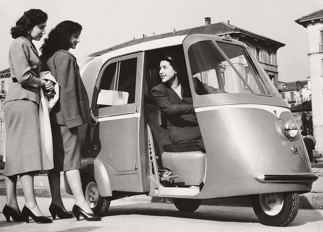 Two women hailing a Vespa Taxi-Scooter, in Milan. April 1952. (Keystone / Getty Images)
