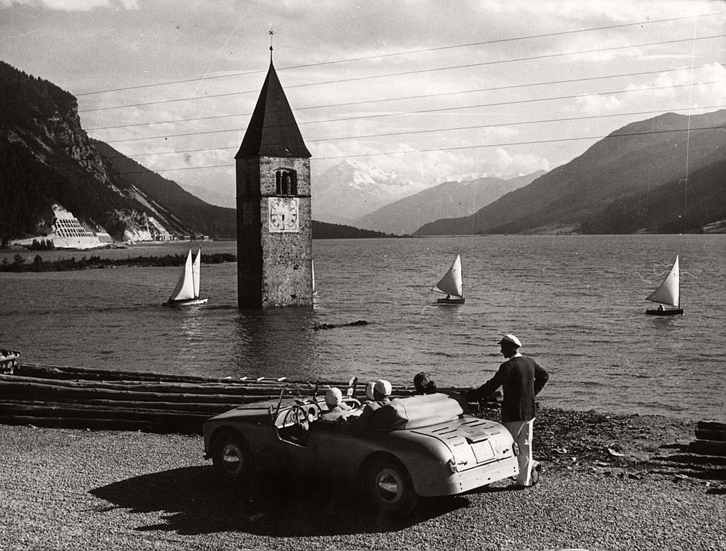 The Reschen Lake in southern Tyrol, which covers the sunken village of Graun, on August 13, 1953. (Keystone / Getty Images)