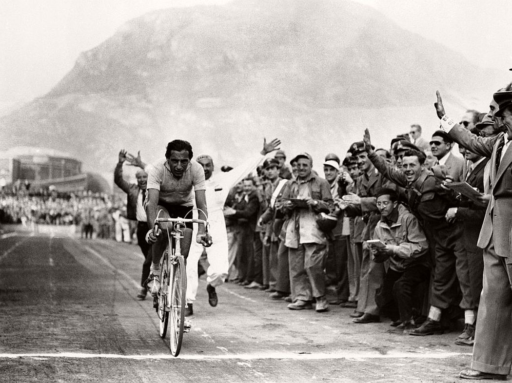 Italy's Fausto Coppi finishing the seventeenth lap of the bicycle race across Italy. June 1952. (AP Photo/B)