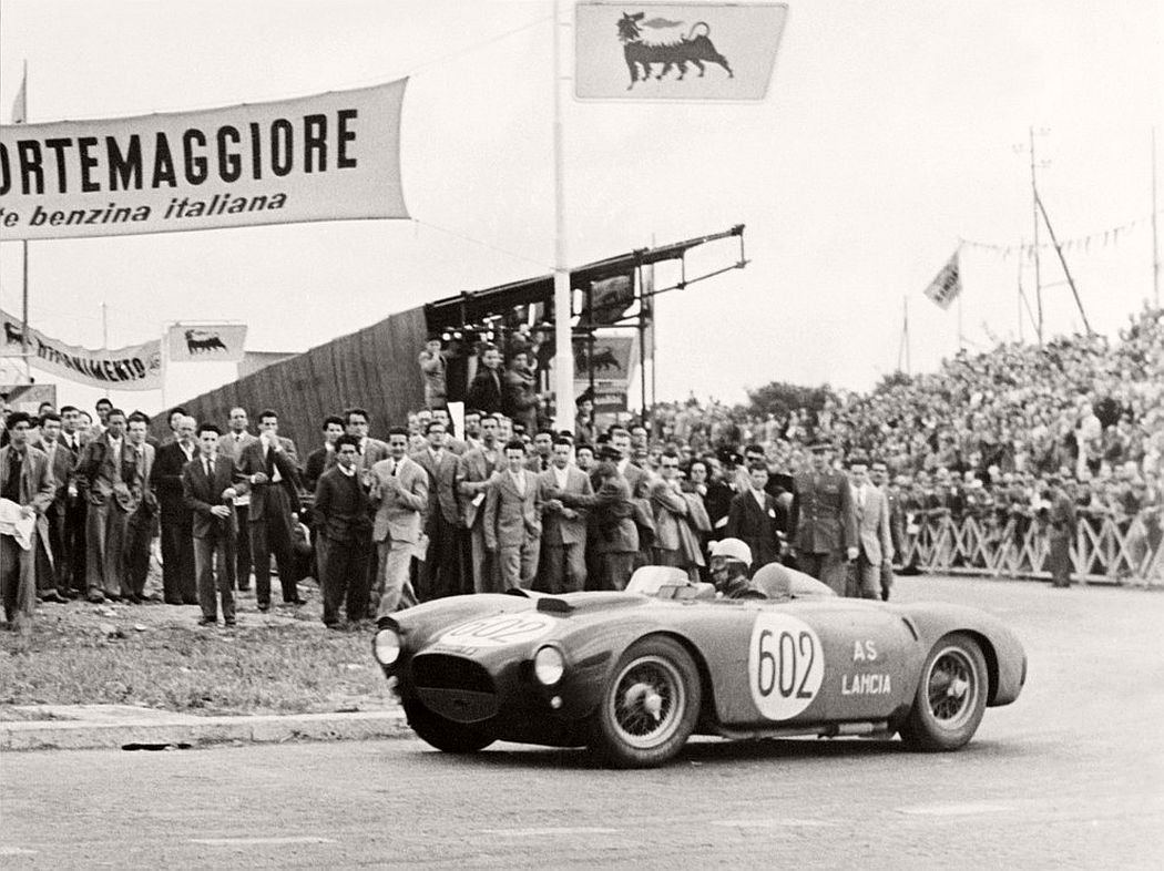 Italian driver Alberto Ascari steers his Lancia at the finish line of the 1000 Miles race in Rome. May 1954. (Stf / AFP / Getty Images)
