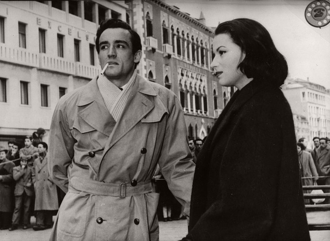 Italian film stars Vittorio Gassman and Silvana Mangano wait for a take in Venice. February 1954. (AP Photo)