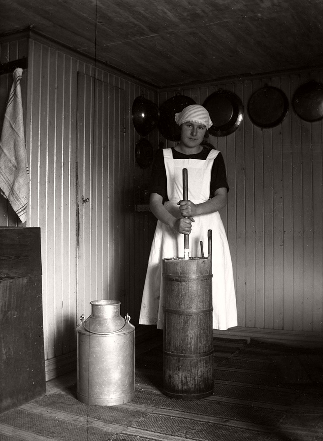 Ulla Göransson churning butter in the old way, ca 1920.