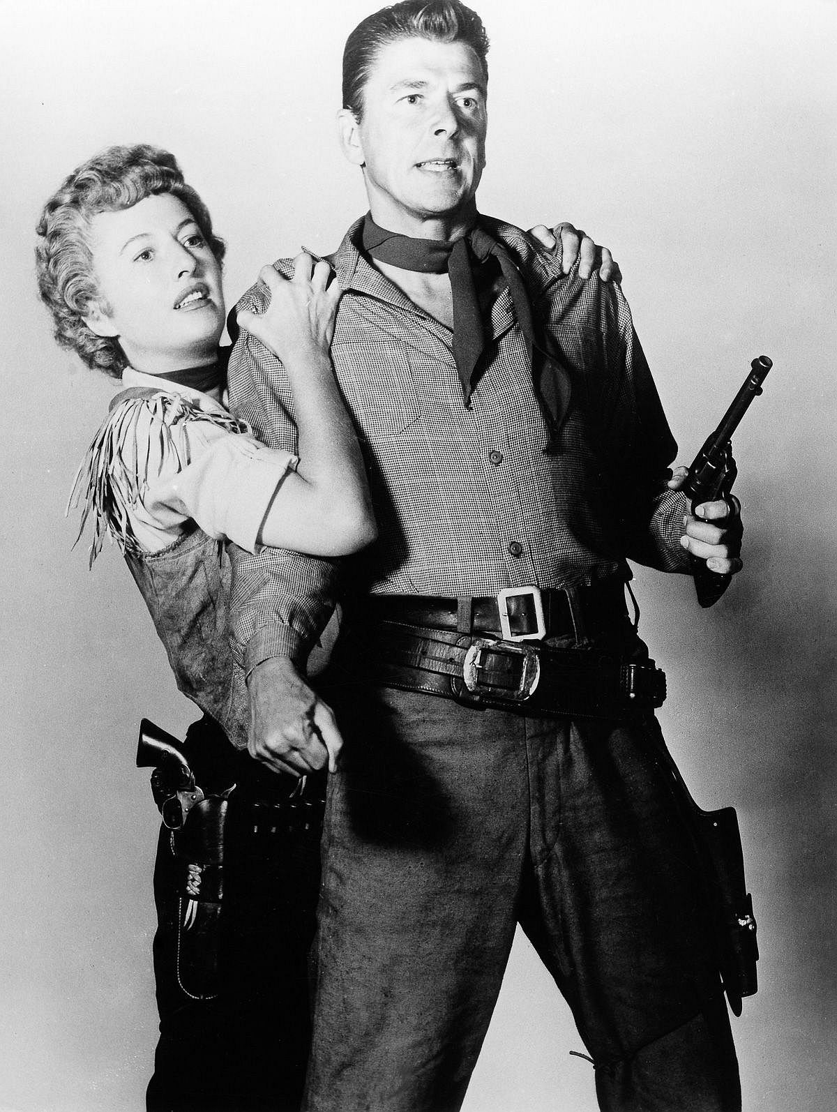 1954  Reagan and Barbara Stanwyck pose for a promo still for Cattle Queen of Montana.  Image: Pressefoto Kindermann/ullstein bild/Getty Images