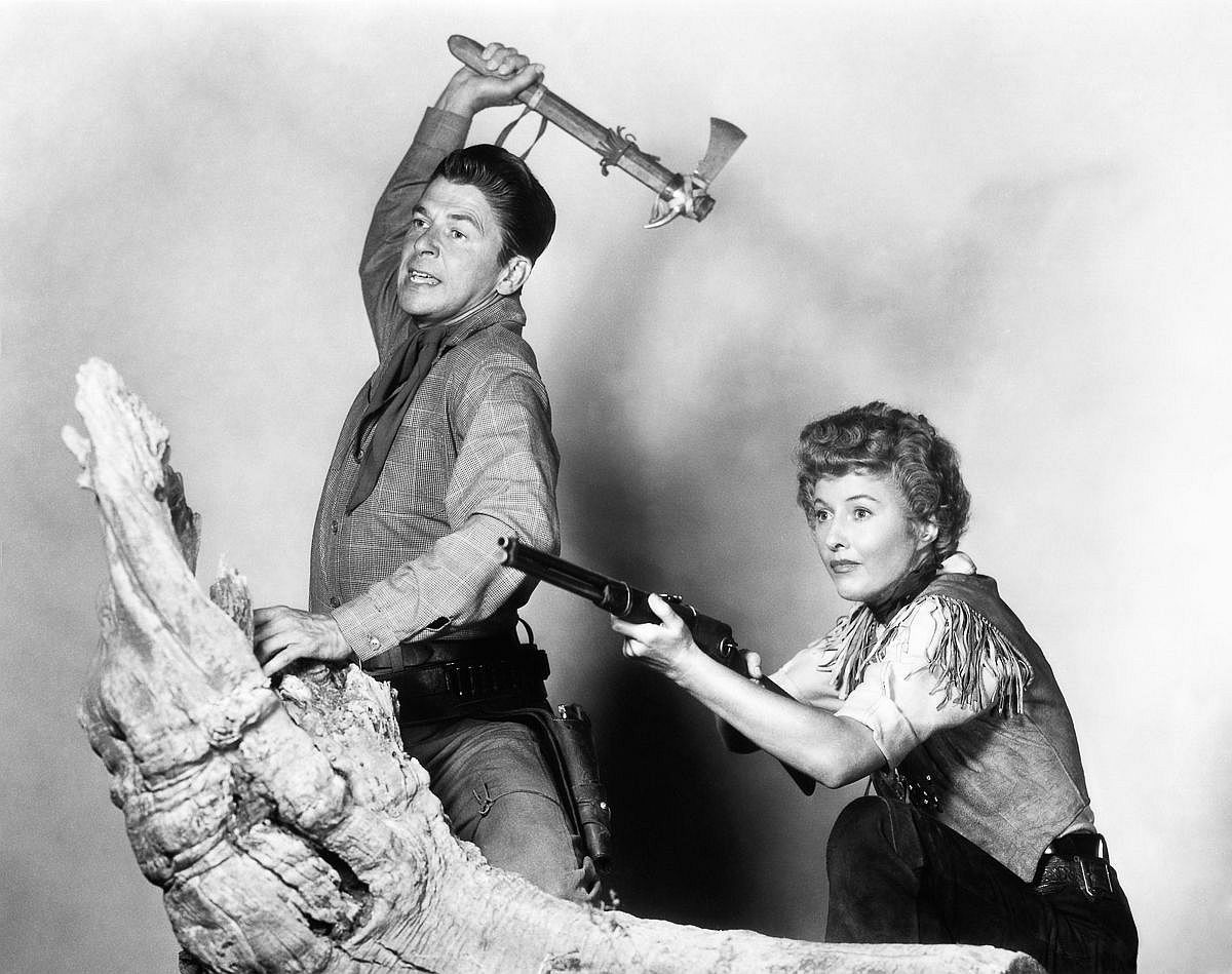 1954  Ronald Reagan and Barbara Stanwyck in a publicity still for Cattle Queen of Montana.  Image: CinemaPhoto/Corbis
