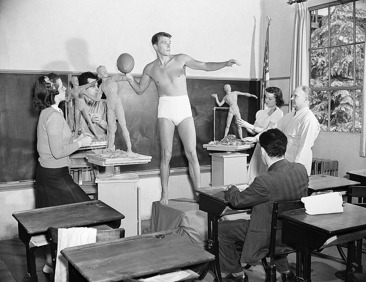 May 2, 1940  Ronald Reagan poses for a sculpture class at the University of Southern California.  Image: Bettmann/Corbis