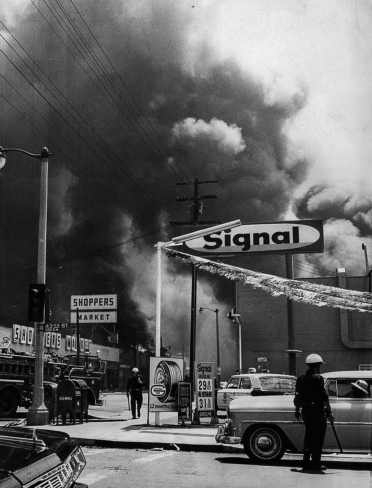 Aug. 14, 1965: Smoke from a row of buildings burning on Central Ave., south of 43rd St. darkens sky during Watts Riots.
