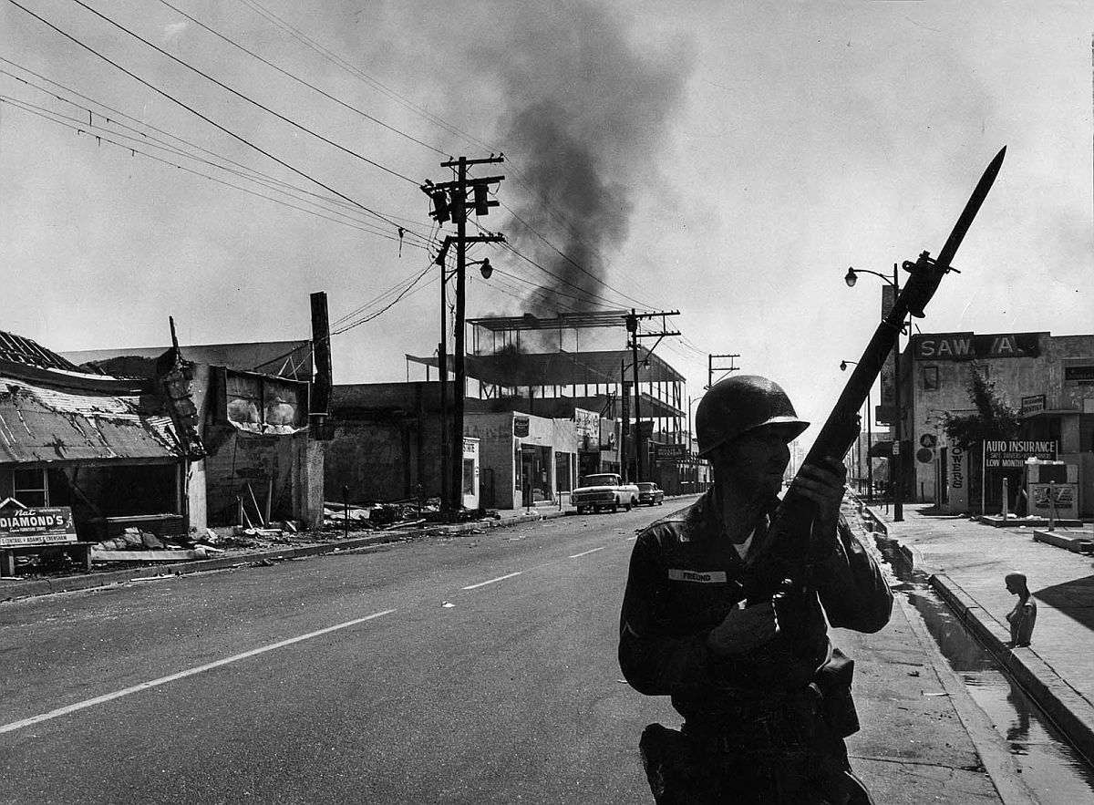 Aug. 14, 1965: A California National Guardsman patrols 103rd St. near Compton Ave. in Watts business district.