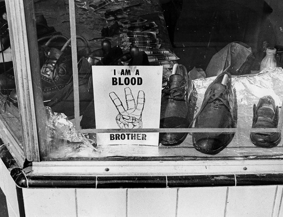 Aug. 1965: During the Watts Riots, sign sits in window of store owned by African-American. In some cases the signs weer disregarded and the business damaged by rioters.