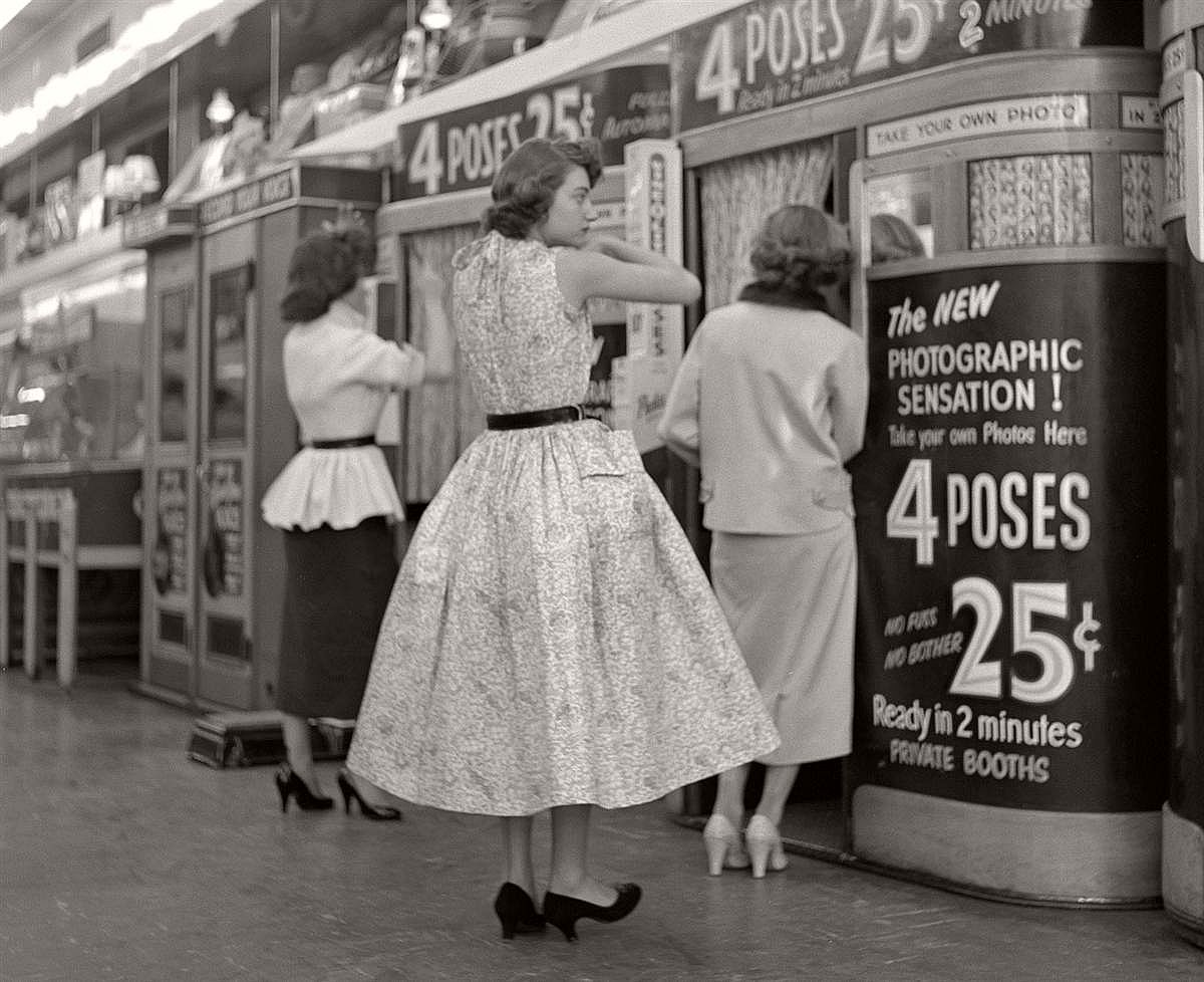 Three young ladies prepare to have their pictures taken in Manhattan photo booths in April 1954.