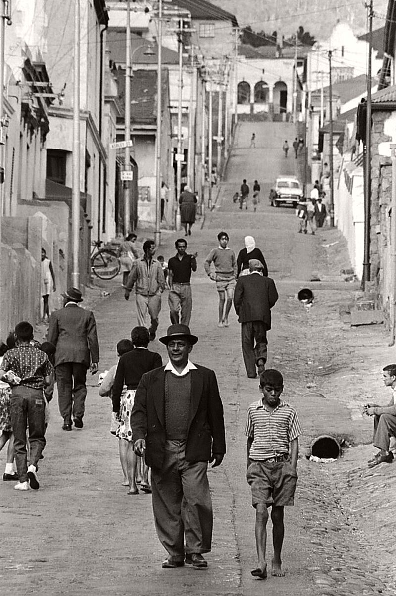 Residents walking down Richmond Street in District Six, Cape Town, South Africa.