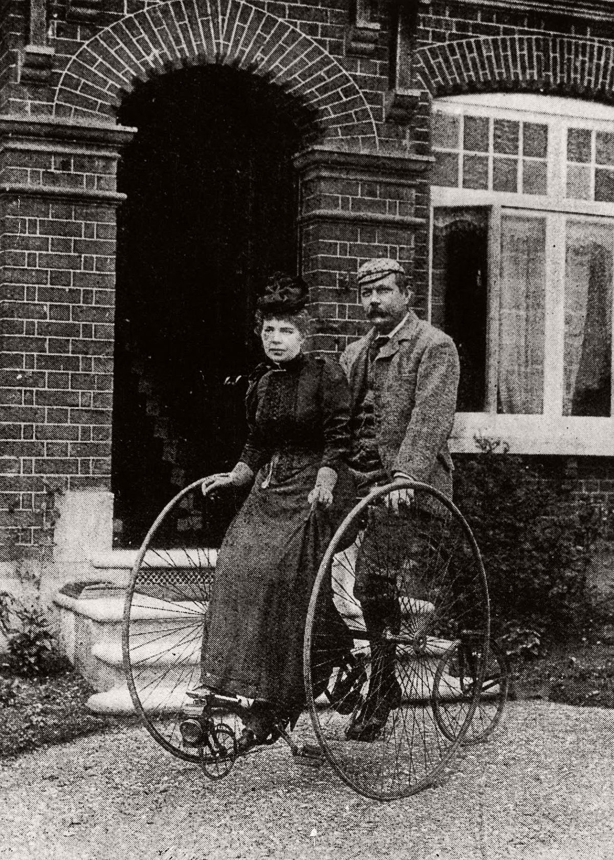 Sir Arthur Conan Doyle and his wife ride a tandem tricycle, 1895. (Getty Images)