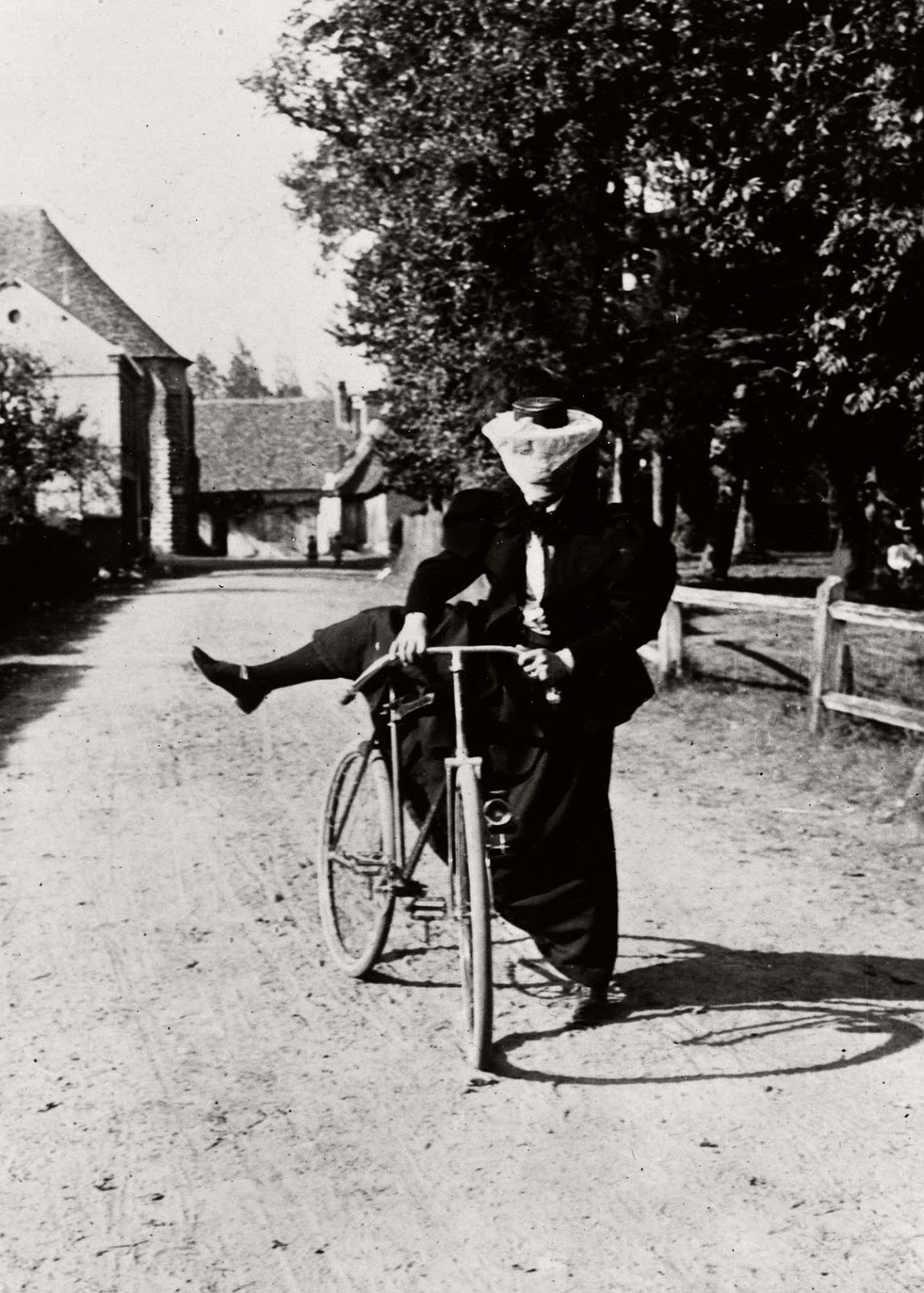 A lady mounts a safety bicycle, 1890. (Getty Images)