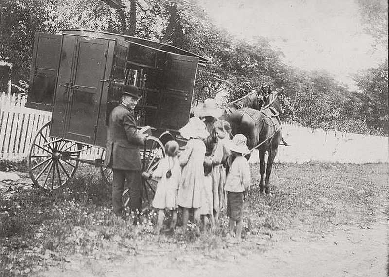 A very old library bookmobile of America, ca. 1900s