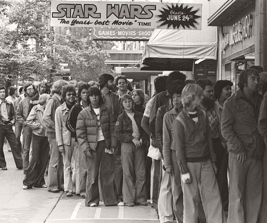 """People waiting in line for """"Star Wars"""" in the summer of 1977. (AP Photo/Glenn Baglo, Vancouver Sun)"""