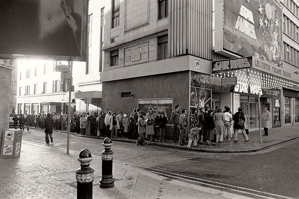 """Theater goers wait in lines in front of the Avco Center Theater in Los Angeles to see """"Star Wars."""" June 7, 1977. (AP Photo)"""