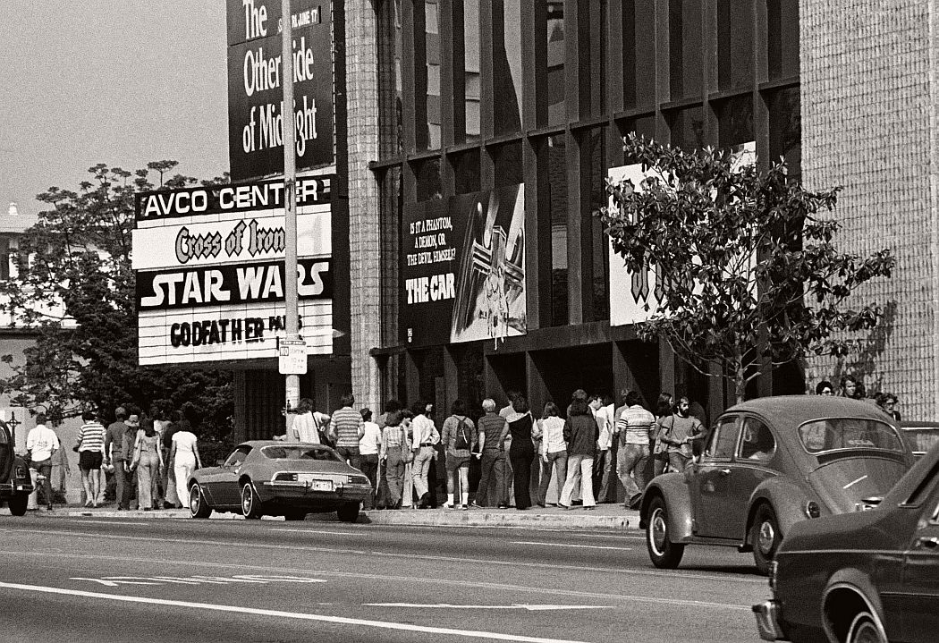 """Theater goers waited in line on June 7, 1977 at Avco Center Theater in Los Angeles to see """"Star Wars,"""" which had seats sold out for every performance since it had opened 12 days prior. (AP Photo)"""