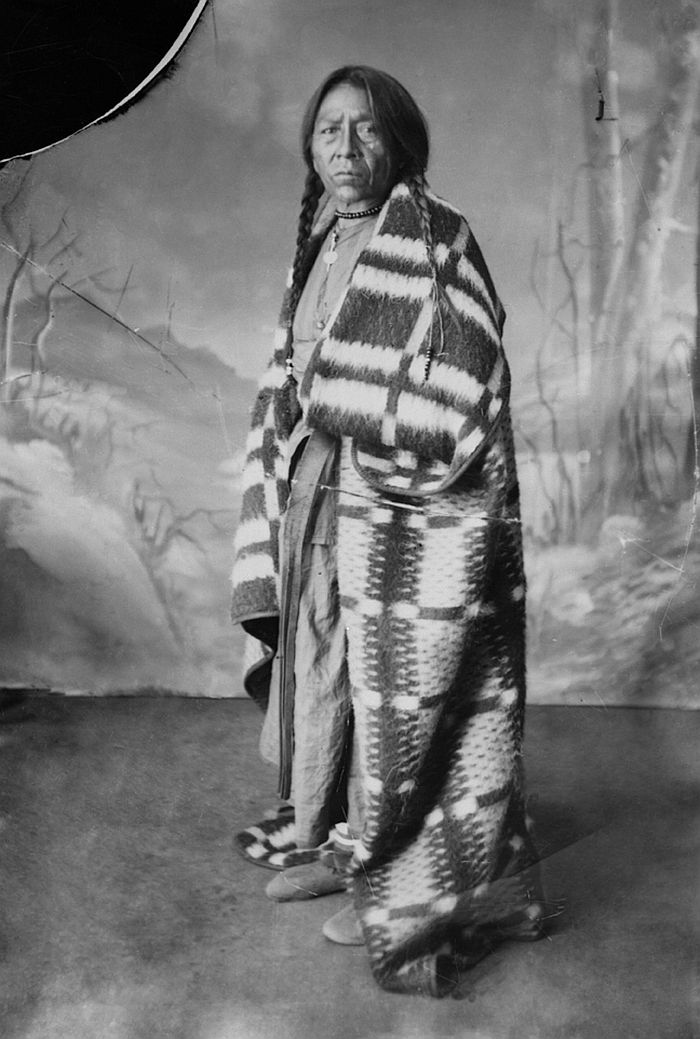 First Nations man in blanket, ca. 1886-90