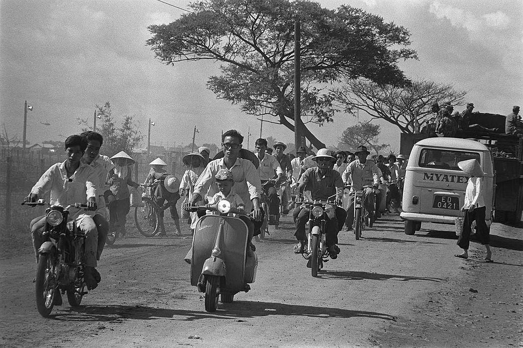 Scooter traffic on road, Saigon, June 1968
