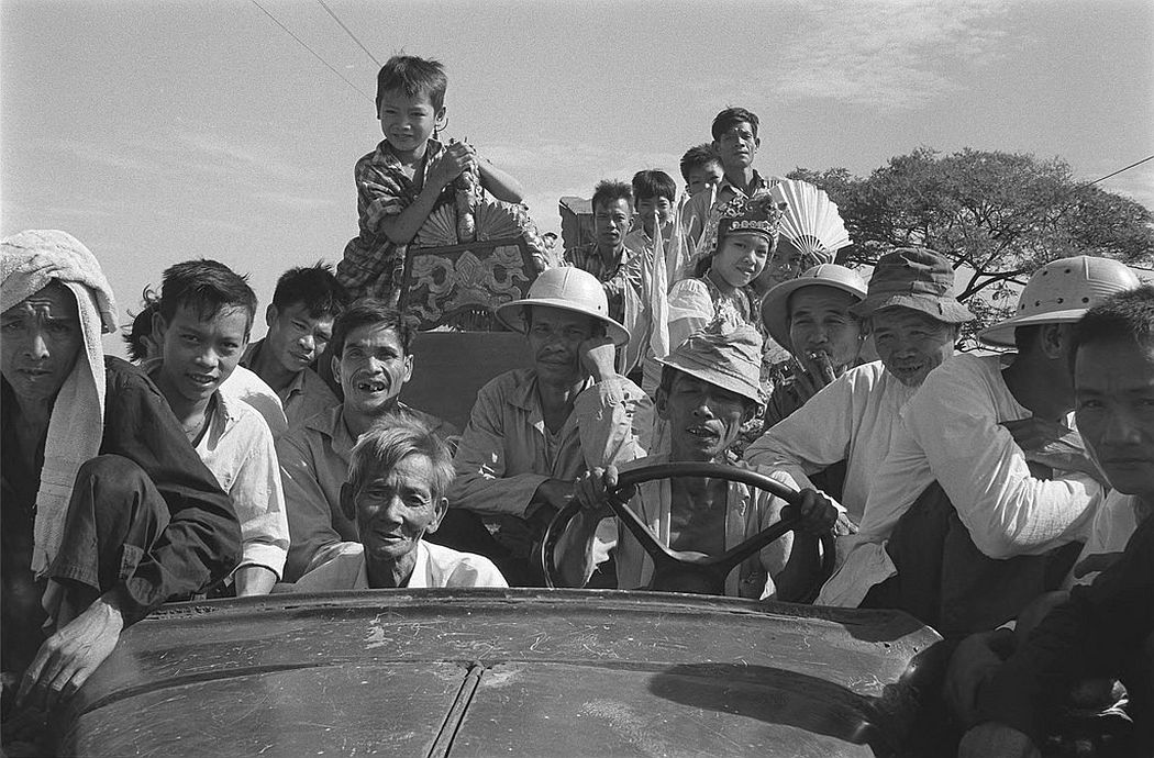 Vietnamese farmers on their way to village festival, June 1968
