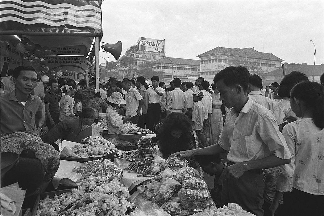 Buying spree and carnival atmosphere at Saigon Central Market, 20 January 1966