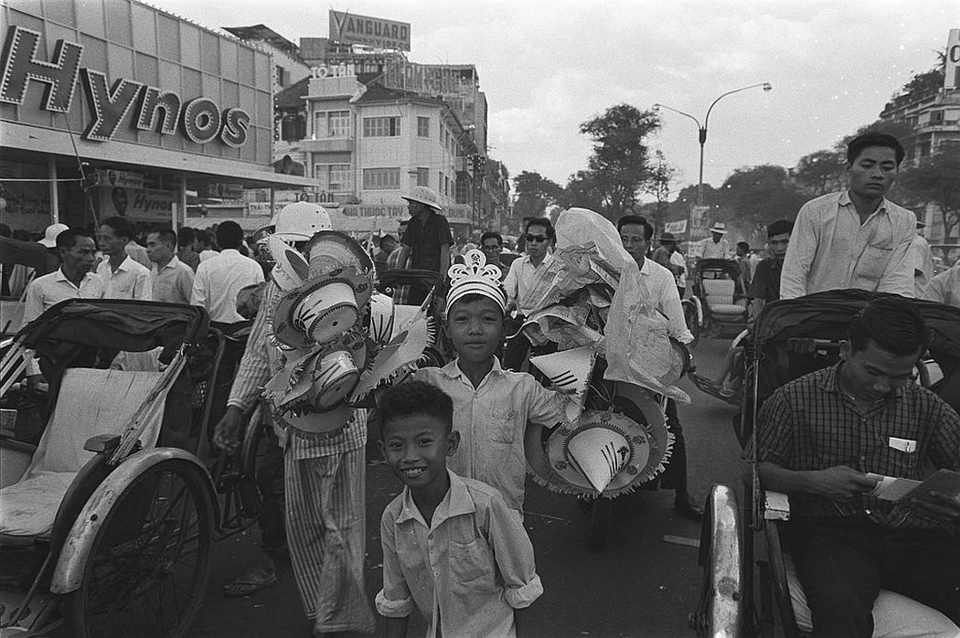 Crowd walking toward the Central and Flower Market at night in Saigon on Vietnamese New Year's Eve, 20 January 1966