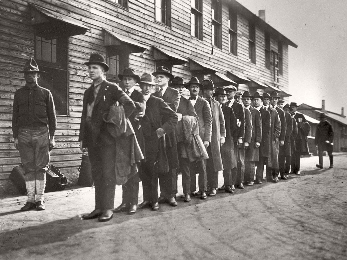 Recruits line up at a New York army camp shortly after President Woodrow Wilson declared war on Germany, in April of 1917. # AP