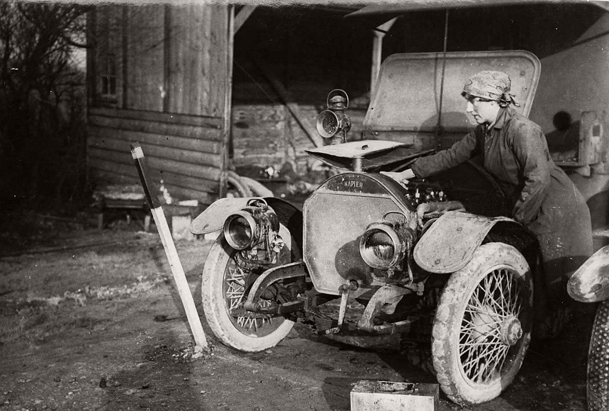 A member of the British First Aid Nursing Yeomanry oiling her car near the Western Front. # National Library of Scotland