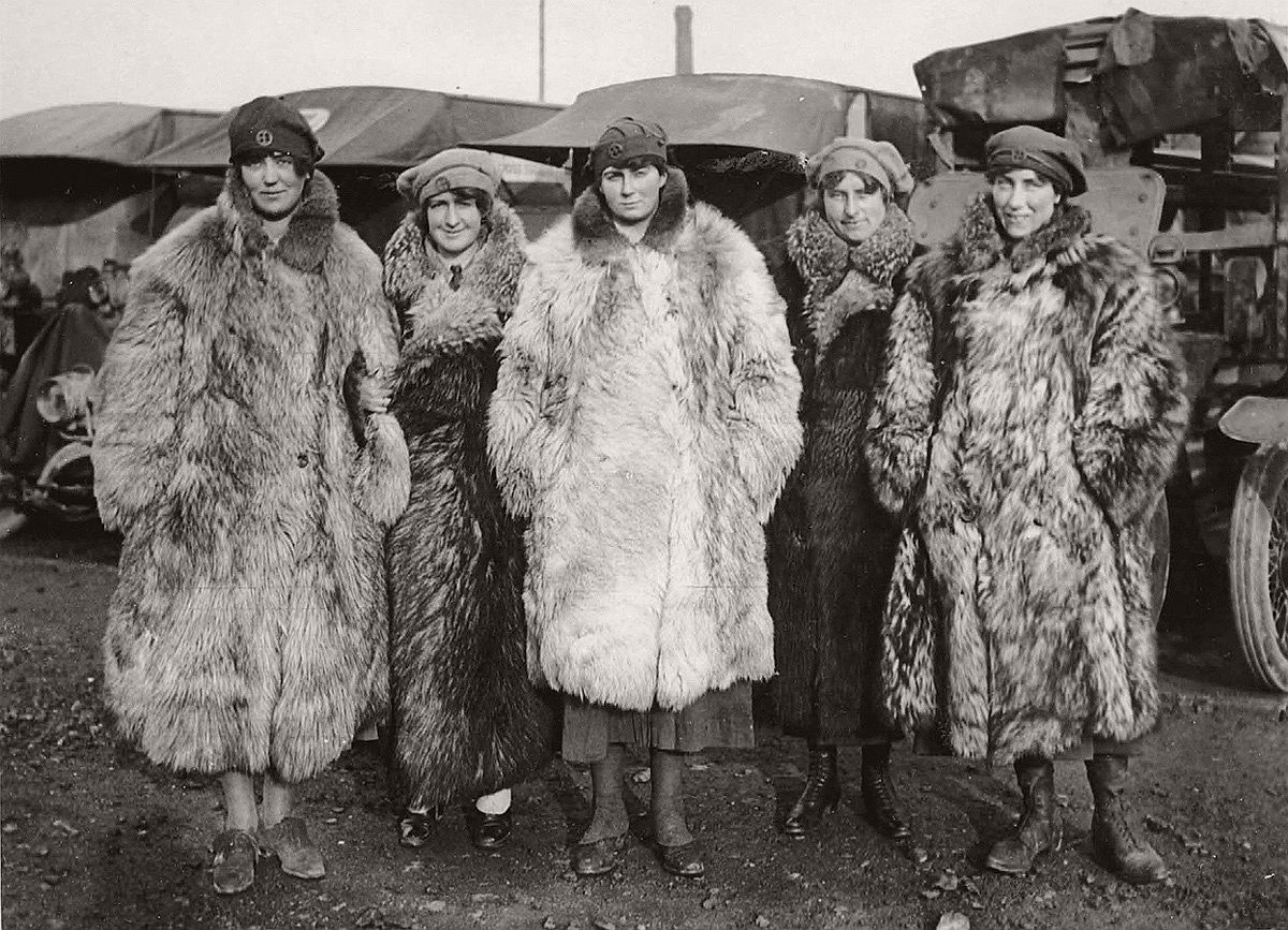 Dressed in a rather exotic uniform of army boots, army caps and fur coats, this image shows five female members of the First Aid Nursing Yeomanry standing in front of some Red Cross ambulances. As the first female recruits of this organization came from the ranks of the upper classes, perhaps the fur coats should not be too surprising. The women would have worked as drivers, nurses and cooks. Established by Lord Kitchener in 1907, the First Aid Nursing Yeomanry (FANY) was initially an auxiliary unit of women nurses on horseback, who linked the military field hospitals with the frontline troops. Serving in dangerous forward areas, by the end of the conflict First Aid Nursing Yeomanry members had been awarded 17 Military Medals, 1 Legion d'Honneur and 27 Croix de Guerre. A memorial to those women who lost their lives while working for the organization, can be found at St Paul's Church, Knightsbridge, London. # National Library of Scotland