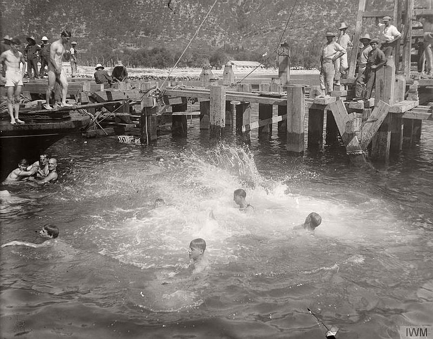 British soldiers splashing in the water at Corfu.