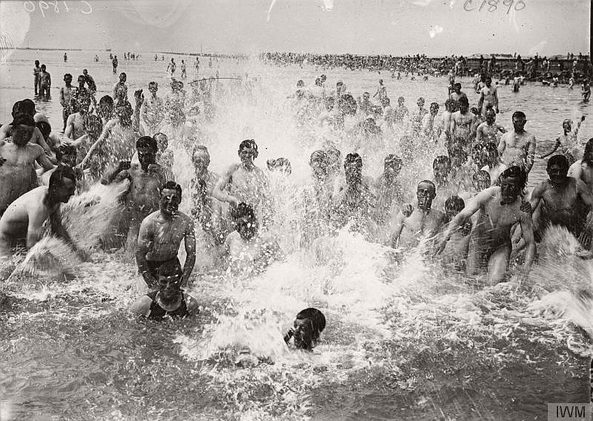 Enthusiastic splashing in the sea at Etaples, France, 1917.