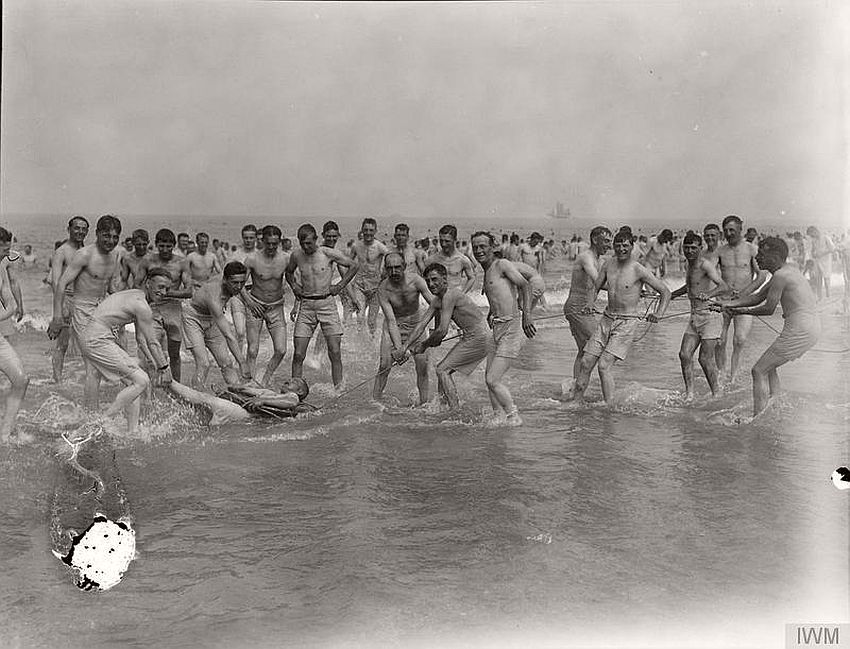 Patients from a convalescent hospital playing in the sea, France, 1918.