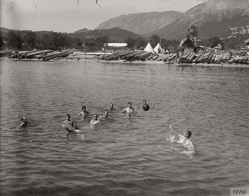 British soldiers playing with a ball in the water at Corfu.