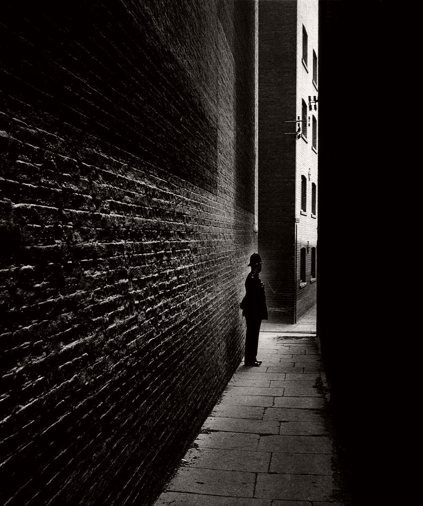 Policeman in a Bermondsey Alley, 1938.