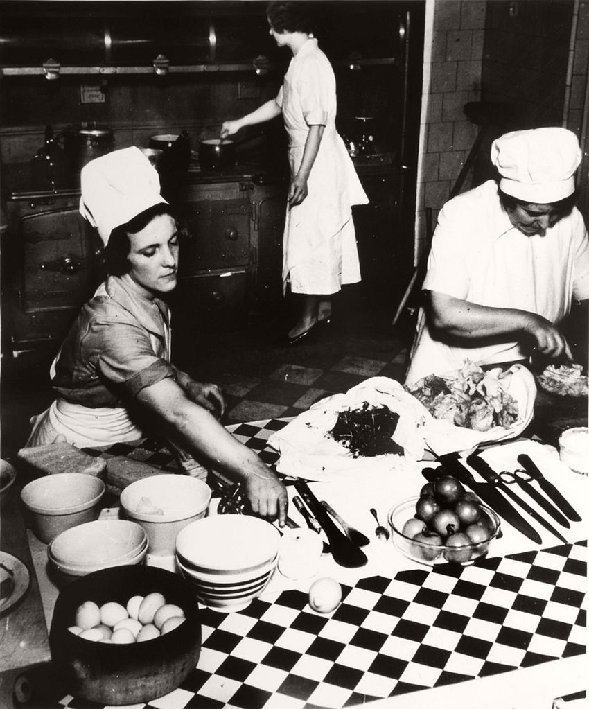 Cook and Kitchen Maids Preparing Dinner, ca. 1936.