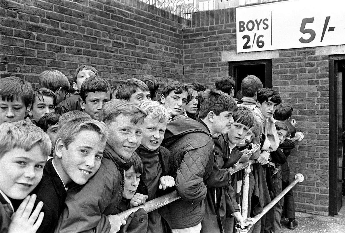 Fans waiting to get into West Ham football club.